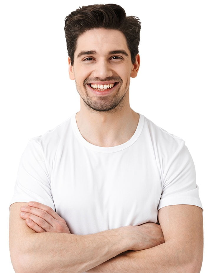 man smiling with crossed arms
